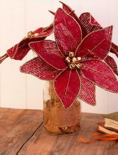 Craft DIY poinsettias out of burlap for a vintage holiday project. Christmas Poinsettia, Burlap Christmas, Handmade Christmas, Christmas Wreaths, Christmas Ornaments, Country Christmas, Christmas Christmas, Burlap Crafts, Christmas Projects