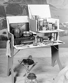 U-BILD 3-In-1 Camp Kitchen Plan combines folding table, stove section and small cabinet. Three pieces fold and store separately.