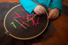 Easy sewing for toddlers -- an embroidery hoop, shelf liner, plastic needle and yarn. | Where the Watermelons Grow