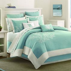 aqua blue bed comforter with coral embroidery accents