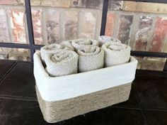 Turn an old tissue or shoe box into a rustic basket using twine and linen cloth.