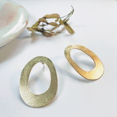 Brass Ovus Studs with frosted finish. Silver ear post and backs. Studs, It Is Finished, Wedding Rings, Brass, Engagement Rings, Earrings, Silver, Jewelry, Rings For Engagement