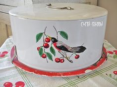 Cake carrier. LOVE THIS! It's like the one I painted for my mom.