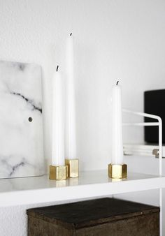 I think you could make these with large nuts from the Hardware store.   candleholders. photo by AMM blog