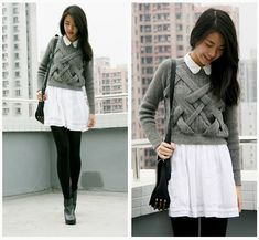 crossed grey knit + white fluttering skirt + black tights + ankle boots