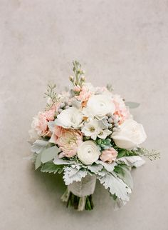 Pastel-hued bouquet with roses, ranunculi, dahlias, brunia berries, and lamb's ear | Photo by Brittany Mahood