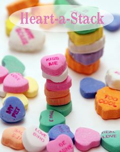Heart-a-Stack – Making a tower of hearts isn't as easy as you think! Buy a few bags of small conversation hearts.  The object of the game is to build the tallest tower in an allotted amount of time (like 30 seconds).  When the time is up, the players counts their hearts to see who is the winner.  This is so much fun!