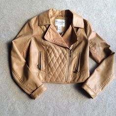 American Rag faux leather jacket This jacket is in excellent condition! The inside of the lapel is fabric, as well as under the arms. American Rag Jackets & Coats