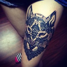 Interesting take on a wolf thigh tattoo