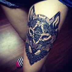Interesting take on a wolf thigh tattoo