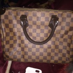 Louie Vuitton purse Got it as a gift .. Great bag.. It's new without tags .. I have lock but no key .. I have dust bag somewhere have to look for it Louis Vuitton Bags