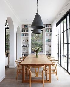 White dining room with large black iron windows and arched doorways. Mid century modern dining room idea, how to decorate your dining room with a century modern feel, mid century modern dining room inspiration Danish Interior Design, White Interior Design, Danish Design, Interior Ideas, Simple Interior, Tree Interior, Interior Office, Luxury Interior, Interior Design Inspiration