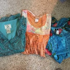 3 Dress Tops  Ice is small Forbidden is small blue with flowers Orange says large but can fit med Mixed Tops