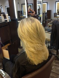 Medium length cascading layers on long hair with pattern matching blonde highlights. @Dres Hair Salon Scottsdale, AZ