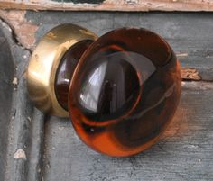 Amber glass and brass cupboard knobs. Handmade to order in the U.K.