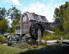 Barbra Streisand chronicles the creation and construction of her newest home in her book My Passion for Design. Seen here, the Mill House on her property has a working water wheel over a man-made pond.