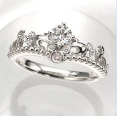 Disney Engagement Ring! Love the shape so it looks like a tiara and the subtleness of the Mickey Mouse! <3