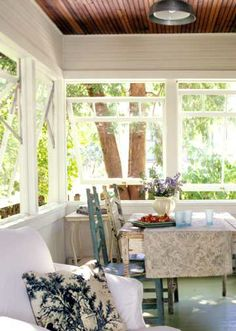 Eat-In Porch              Awning-style tilt-out windows allow breezes in, yet can keep rain and cold outside. A beaded-board ceiling gives the room warmth, and paint freshens up a tired wood floor. Since the room can be closed off from the elements, fully upholstered furnishings can be used