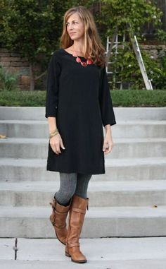little black dress dressed down with boots and tights - want to try to find some tall boots that will fit me...