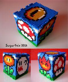 Hucha Mario Bros en hama midi. Si te gusta puedes adquirirla en nuestra tienda on-line: http://www.sugarshop.eu