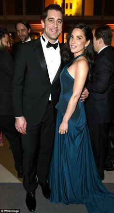 Cute couple: Olivia Munn - wearing Zac Posen - and boyfriend Aaron Rodgers partied the nig...