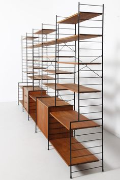 Teak and Enameled Metal String Style Shelving | 1960s - http://www.homedecoz.com/home-decor/teak-and-enameled-metal-string-style-shelving-1960s/