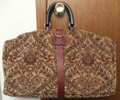 made to look like an 1860s carpet bag. Handles are to modern. wood base laid inside for support of heavy items.