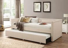Baxton Studio Raymond Modern Beige Linen Fabric Nail Head Trim Twin Daybed with Roll-Out Trundle