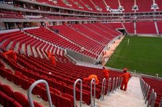 Employees clean the National Stadium Mane Garrincha seats in Brasilia, Brazil, Tuesday, May 14, 2013. The stadium is being remodeled for the upcoming Confederations Cup in June 2013 and the 2014 World Cup soccer tournament. Photo: Eraldo Peres