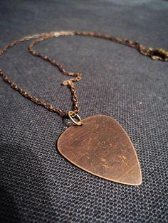 Brass/copper guitar pick necklace.