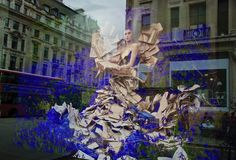 English Literature London by Barbara Parkins Printed on Giclée Hahnemühle Pearl  Throughout history, England and literature go hand in hand. In a London shop window a series of visual creations. A maiden, her gown of pages of literature. Standing amidst bluebells. The reflection on the window catches Regent Street's beautiful buildings, an iconic London red bus. It has given me natural layers.   Colour photograph printed on premium quality photographic paper.  Photographer: Barbara Parkins. Photography Gallery, Street Photography, Art Photography, London Red Bus, English Literature, Female Photographers, Beautiful Buildings, Reflection, Layers