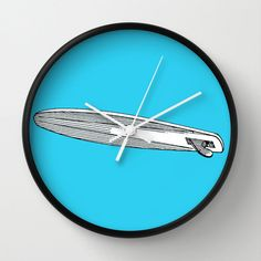 """surf Clock, Modern Wall Clock, Modern Clock, The Modern Clock, blue clock, wood pattern clock, modern wall clock by STANLEYprintHOUSE  47.00 USD  Available in natural wood, black or white frames, our 10"""" diameter unique Wall Clocks feature a high-impact plexiglass crystal face and a backside hook for easy hanging. Choose black or white hands to match your wall clock frame and art design choice. Clock sits 1.75"""" deep and requi ..  https://www.etsy.com/ca/listing/259121659/surf-clock.."""