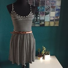 Black and white striped dress Worn once, this dress is in great shape. Belt not included. Charlotte Russe Dresses Mini