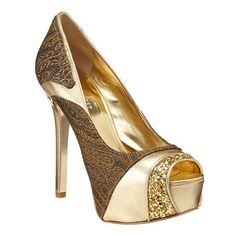 """As seen in the December issue of People Style Watch.....mixed material peep toe pump with detailed heel.  5 1/4"""" heel with 1 1/2"""" platform."""