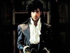 Prince in character as The Kid, the protagonist of his now-iconic film, Purple Rain. - Alamy