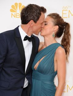 Pin for Later: Relive the Best Moments From the 2014 Emmys  Seth Meyers planted a kiss on his wife, Alexi.