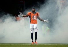 Description of . Wide receiver Emmanuel Sanders (10) of the Denver Broncos takes a bow as he enters the field prior to the start of the game.  The Denver Broncos vs the Seattle Seahawks At Sports Authority Field at Mile High. (Photo by John Leyba/The Denver Post)