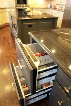 Two pull-out refrigerated drawers in the kitchen center cabinet area help the Fretzin family keep a kosher kitchen. The family also has a large, two-door refrigerator.