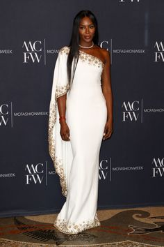 Naomi Campbell attended the Monte Carlo Fashion Week opening party. She wore a luxury white custom one shoulder prom dress with gold beads in this Fashion Week. Celebrity Wedding Dresses, Bridal Wedding Dresses, Bridal Style, Naomi Campbell, Look Fashion, Runway Fashion, One Shoulder Prom Dress, Evening Dresses, Prom Dresses