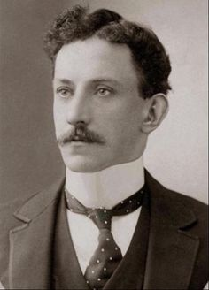Young gentleman, circa 1900, wearing a very high, stiff, upright collar and tie.