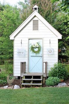 "Blogger <a href=""http://daisymaebelle.com/craft-room-tour/""> DaisyMaeBelle</a> gave her children's old playhouse a new lease on life as her craft shed. Birds have taken to nesting in the sweet little bell tower on the roof."