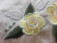 The Embroiderer's Prayer roses in shades of yellow.