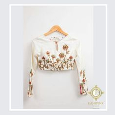 Beautiful floral creepers embroidered high neck blouse with full sleeves.<br>Sleeves also has buttons design and flowers. Sari Blouse Designs, Fancy Blouse Designs, Designer Blouse Patterns, Bridal Blouse Designs, Blouse Styles, Designer Dresses, Full Sleeves Blouse Designs, Stylish Blouse Design, Lesage