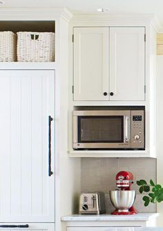 Doorless box units constructed above the refrigerator and/or under cabinets are easy, integrated solutions for storage baskets and a microwave. More from this kitchen: http://www.midwestliving.com/homes/decorating-ideas/country-kitchen-decorating-ideas/?page=5