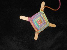 Use Yarn & Popsicle Sticks to Make this Craft: How to Make God's Eyes