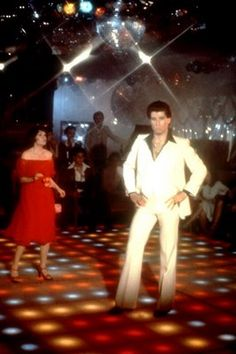 Saturday Night Fever is defintely a movie that helped make Disco music mainstream. Tony Manero's white suit and black polyester shirt define for some the whole late 70s fashion. In my opinion it's an example but not the only look that represents the late 70s for men's fashion.