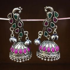 German Silver multi Stone Jhumka earring. Many colours and designs available. Shipping world wide true Normal and express fast courier . For enquiry of price Email us or direct message us. #unitedstates #dubai #bahrain  #america #spain #turkey #istanbul #iran #germany #california #newyork #boston #costarica #australia #england #france #canada #lebanon  #paris #italy #romania #ashmarjewelry #texas #newhampshire #miami #florida #brazil #russia #chile #madrid