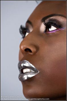 chrome lips. All of her makeup is beautiful on her skin! Especially the lipstick color!