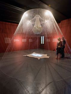Kent Monkman (born 1965), Cree; Théâtre de Cristal, 2007; Chandelier, plastic beads, acrylic string, cabouchons, simulated buffalo hide, and Super-8 film: Group of Seven Inches, 2005 (7:34 minutes), edition 1/3; 168 x 240 inches (diam. approx.) (426.7 x 609.6 cm); The Glenbow Museum, Alberta, Canada
