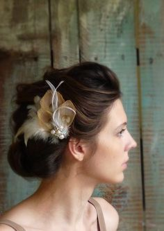Peacock and Ivory Feather Hair Fascinator with a Vintage Crystal and Pearl Art Deco Jewelry Piece. $90.00, via Etsy.